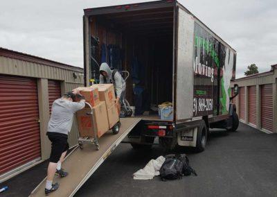 Casey and Kieran loading truck